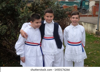STITAR, CROATIA - OCTOBER 28, 2018: Boys dressed in folk costumes go to the church at the Mass on Thanksgiving day in Stitar, Croatia