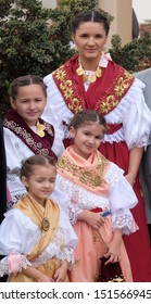 STITAR, CROATIA - OCTOBER 28, 2018: Girls dressed in folk costumes go to the church at the Mass on Thanksgiving day in Stitar, Croatia