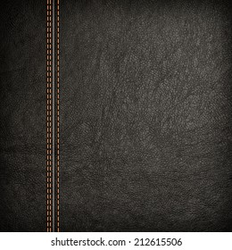 Stitched leather background in dark colors. Close up.