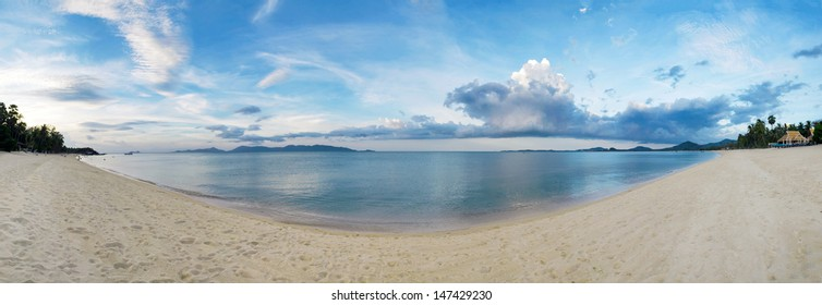 Stitched panorama of exotic tropical beach under blue sky. Thailand