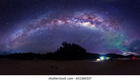 Stitched Panorama night sky with milkyway. image contain noise due to high ISO and soft focus due to wide aperture.