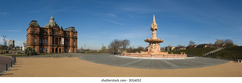 A stitched panorama of six photographs of the People's Palace Museum and the Doulton Fountain, Glasgow Green , Scotland