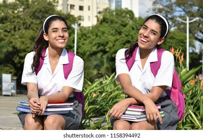 Stitched Photo of Happy Teen Female Student Posing As Twin Sisters