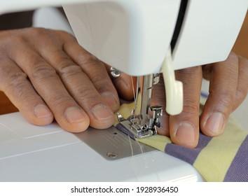 stitching clothing with sewing machine stock photo