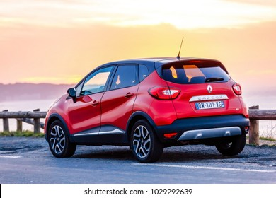 St-jean de Luz, France - September 26, 2016 : Red Renault captur on by the sea on a beautiful sunset in the background. It is Russian version of subcompact crossover Renault Captur with extended wheel