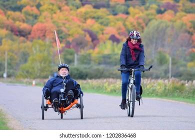 St-Joachin, Quebec / Canada - October 14, 2018: Riiding a trike along the Trans-Canada trail.
