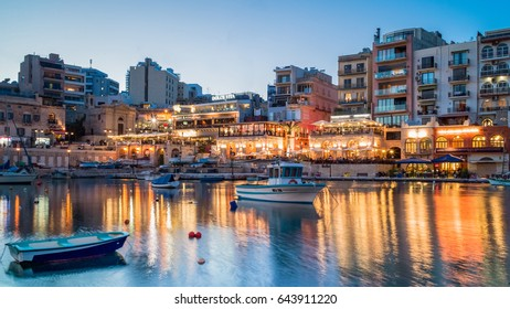 ST.JULIAN'S, MALTA, APRIL 15, 2017 - Spinola Bay in St.Julian's at dusk - St.Julian's, Malta