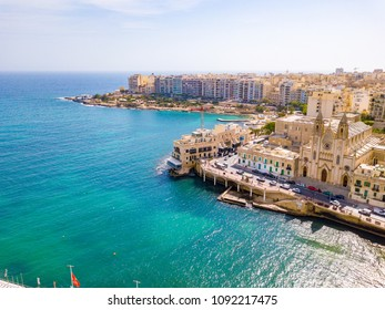 ST.JULIAN'S, MALTA, MAY 15, 2018 - Aerial view on the Spinola Bay with outside pool in St.Julian's from above - St.Julian's, Malta