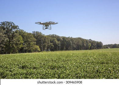 St.Louis Missouri. -August 24th : Editorial photo of a DJI Phantom 3 professional drone in flight with a mounted 4k digital camera on August 24th 2015 in St.Louis Missouri over Soybean field