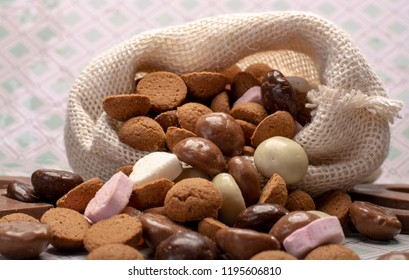 St.Nicholas day in December, children holiday in Netherlands, Belgium, Germany and Curacao, chocolate spicy ginger cookies and letters in white burlap sack close up