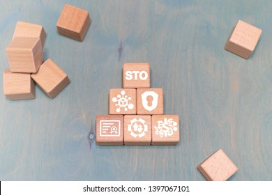STO Security Token Offering. Modern ICO wooden blocks financial concept.