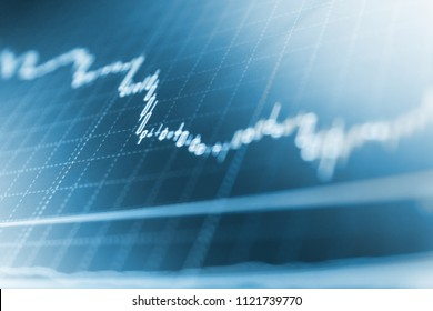 Stock analyzing. Blue background with stock chart. Financial diagram with candlestick chart. Stock market concept and background. Bitcoin price watch.