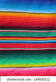 Mexican poncho stock cinco de mayo serape background blanket cinco de mayo Mexico traditional culture fiesta with striped pattern and copy space popular souvenir  tourists photo, photograph