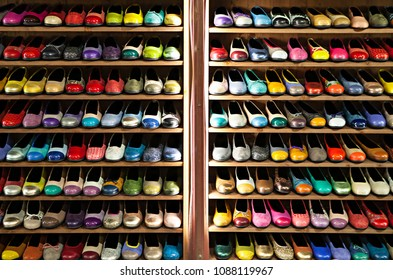 Stock collection of colorful ballerinas shoes shelves store. A number of womens shoes stained with different colors. Shelving in a shop of womens shoes. Shoes are ballerinas.