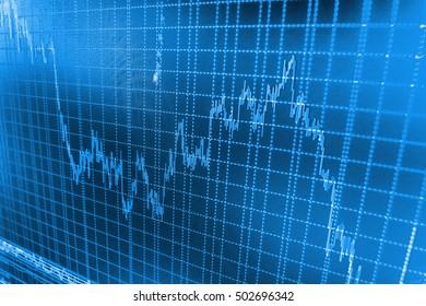 Stock diagram on the screen. Macro close-up. Data on live computer screen. Blue background with stock chart. Professional market analysis. Stock market graph and bar chart price display.
