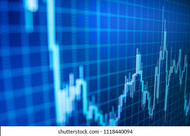 Stock exchange graph. Financial statistic analysis on dark background with growing financial charts. Analysing stock market data on a monitor. Bullish point, Bearish point trend of graph.