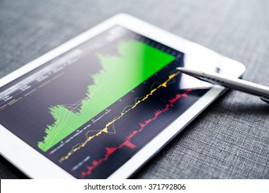 Stock exchange graph on tablet pc