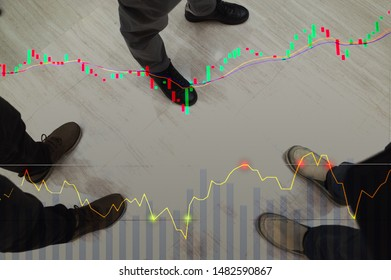 Stock graph chart candlesticks with RSI and EMA Indicators, Stock Trader's leg are standing for analysis on background, stock markets graph analysis concept