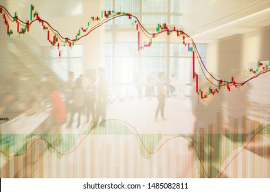 Stock graph chart with EMA and MACD indicators and volume bar, blurred business people on background, stock trading by macd indicator concept