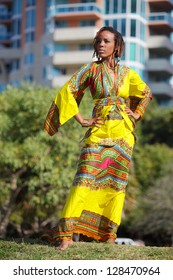 Stock image of an African American woman wearing traditional African clothing
