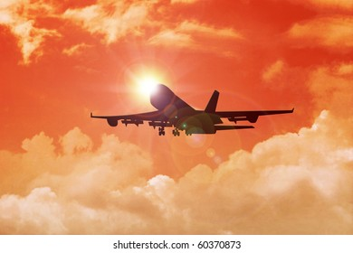 Stock image of airplane flying toward the sun