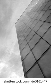 Stock image of black and white bottom view on the front elevation glass wall of unknown building's corner