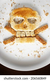 Stock image of bread skull and crossbones on white plate