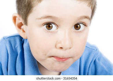 Stock image of cute kid wearing blue shirt over white background