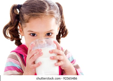 Stock image of female child drinking glass of milk