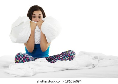 Stock image of insomniac woman on bed over white background