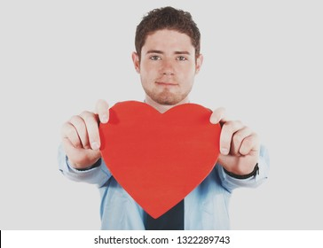 Stock image of man holding a heart shape