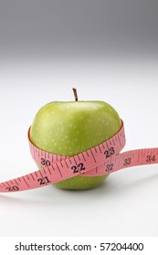 stock image of the measuring tape on apple