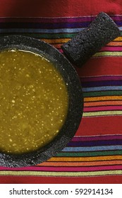 Stock image of mexican salsa verde on mortar and pestle