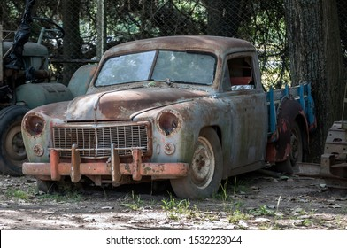 Stock image of an old, rusted, abandoned car.