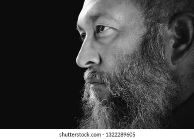 Stock image portrait of bearded man, black and white.