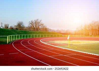 Stock image of a running track in an evening sunset signifying concept of dreams and aspirations
