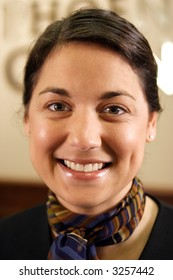 A stock image of a smiling hotel concierge.