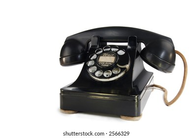A stock image of a vintage 1940's rotary phone isolated on white. Room for text.