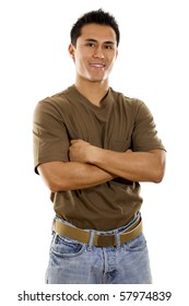 Stock image of young adult standing with arms crossed over white background