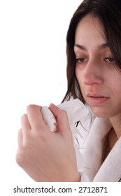 A stock image of a young woman with a bad cold.