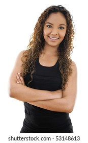 Stock image of young woman standing with arms crossed over white background