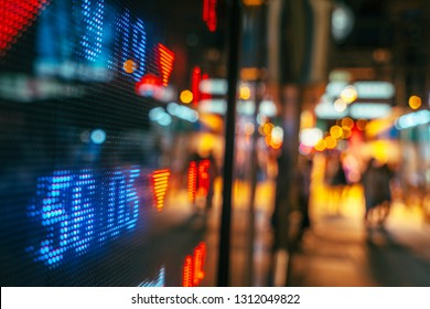 stock index numbers with city scene reflect on glass