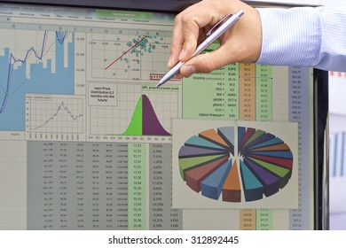 Stock market analyzing with pen on hand