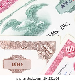 Stock market collectibles. Old stock share certificates from 1950s-1970s (United States). Vintage scripophily objects (obsolete). Square composition.