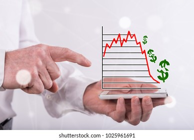 Stock market crash concept above a smartphone held by a man