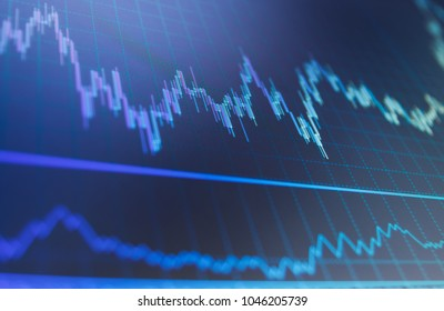 Stock market graph and bar chart price display.  Forex market charts on computer display. Market analysis for variation report of share price. Stock market quotes on display. Shallow DOF.