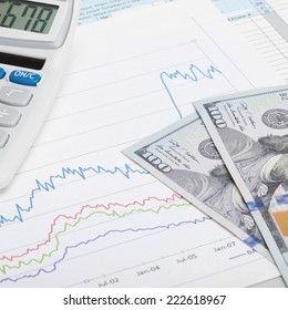 Stock market graph with US dollars banknote and calculator - 1 to 1 ratio