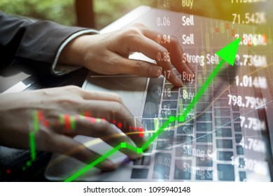 Stock market investing concept with computer laptop keyboard for online business investment.  Risk versus reward for growing economy concept.