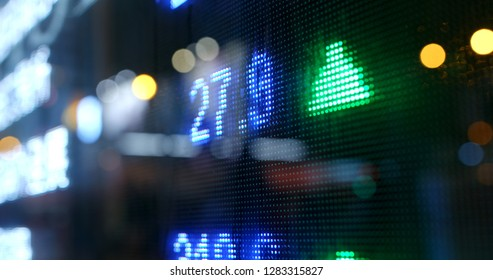 Stock market quotes in city at night