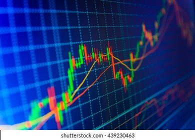 Stock market quotes on display. Stock diagram on the screen. Stock exchange graph. Market trading screen. Finance concept. Blue background with stock chart. Currency trading theme.